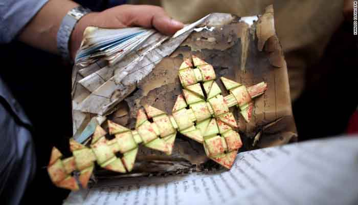Security personnel bag a cross as evidence, Church bombing in Tanta, Egypt