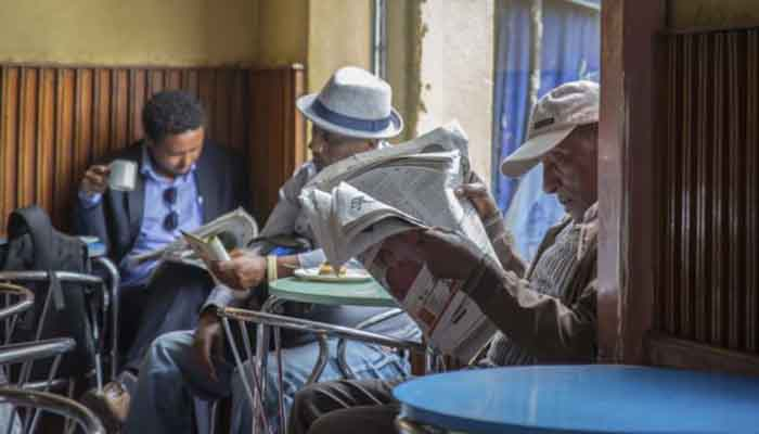Ethiopian men read newspapers at a cafe in Addis Ababa, Ethiopia on Oct. 10, 2016.