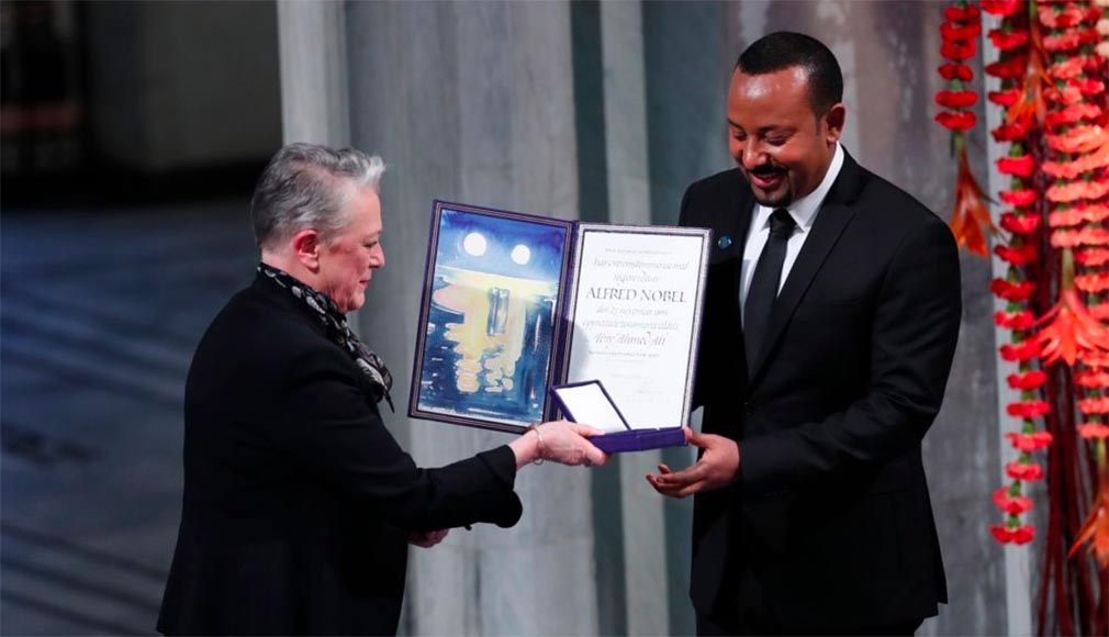 Ethiopia's Prime Minister Abiy Ahmed is presented by the Chair of the Nobel Committee Berit Reiss-Andersen, left, during the Nobel Peace Prize award ceremony in Oslo City Hall, Norway, Tuesday Dec. 10, 2019.